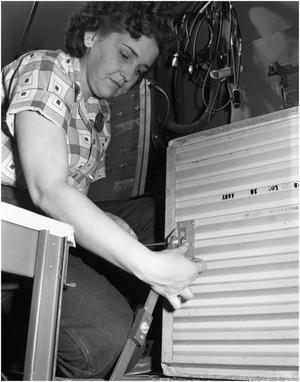 Primary view of object titled 'Myrle Lyons working on B-36 fuselage'.