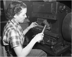 Primary view of object titled 'Billie Wafford operating Multi-punch'.