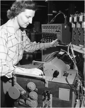 Primary view of object titled 'Gladys Brogdon at work in Engineering Test Lab'.