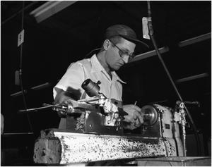 Primary view of object titled 'D.M. Anderson working at Turrret Lathe'.