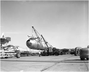 Primary view of object titled '[Working on plane B-36, No. 13]'.
