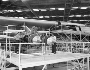 Primary view of object titled 'Men working on a B-36 jet engine'.