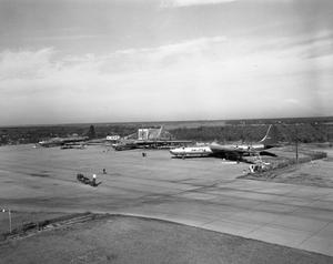 Primary view of object titled 'Three B-36's in Yard'.