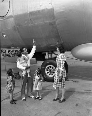 Primary view of object titled 'Ike Palhamus and family inspects B-36 on Air Force Day'.