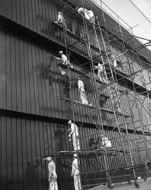 Primary view of object titled '[Paint Crew on Hangar Building]'.