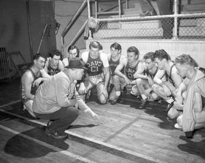 Primary view of object titled '[Basketball Team Huddled Around Coach]'.