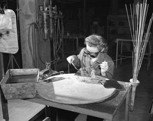 Primary view of object titled '[Eva Shumaker at Welding Table]'.