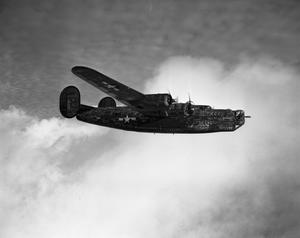 Primary view of object titled '[Decorated B-24 in Flight]'.