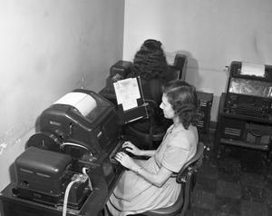 Primary view of object titled '[Female Working on the Teletype]'.
