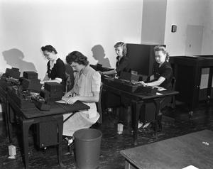 Primary view of object titled '[Four Women Working at Desks]'.