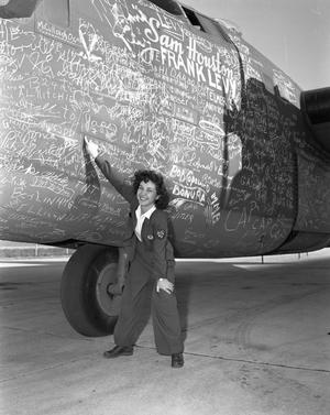 Primary view of object titled '[Winona Keller Pointing at Aircraft]'.