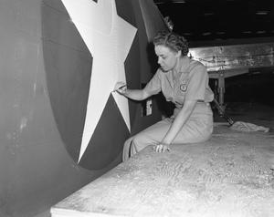 Primary view of object titled '[Helen Perkins Painting an Aircraft]'.