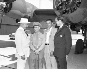 Primary view of object titled '[Four Men Standing in Front of Aircraft]'.