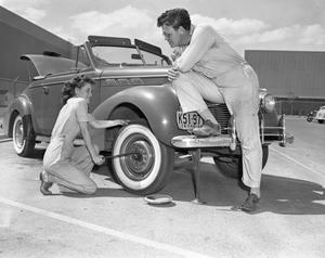 Primary view of object titled '[Chas Matthews and Wife Change Tire]'.