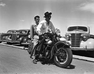 Primary view of object titled '[Two Men Riding a Motorcycle]'.