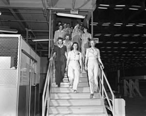 Primary view of object titled '[Group of Women Walking Down a Staircase]'.