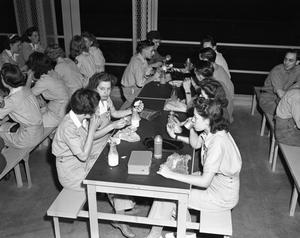Primary view of object titled '[Employees Eating at Tables]'.