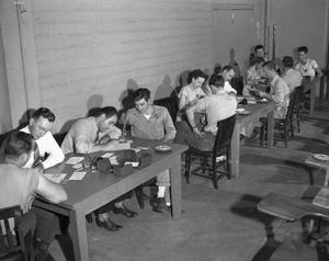 Primary view of object titled '[Draftees Signing Up in Conference Room]'.