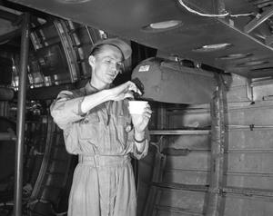 Primary view of object titled '[Raymond E. Fisher Inside the Cabin of a B-36]'.