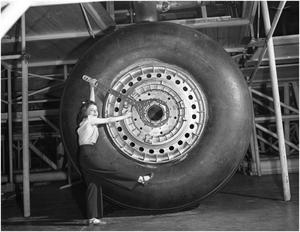 Primary view of object titled 'Grace Purcelly with a B-36 Tire'.
