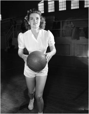 Primary view of object titled 'Ida Jean Smith playing basketball'.