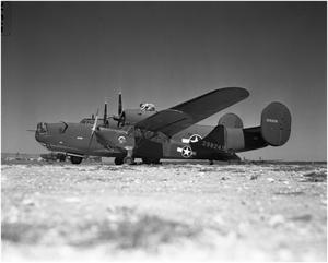 "Primary view of object titled 'Flying ""Jeep"" and a B-24'."