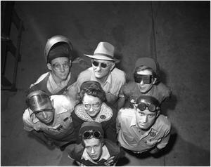 Primary view of object titled 'Welders Demonstrating Different Types of Safety Goggles'.