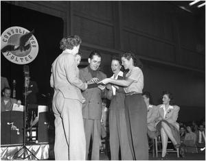 Primary view of object titled 'Frankie Masters signing War Bond at Lockheed Martin performance'.