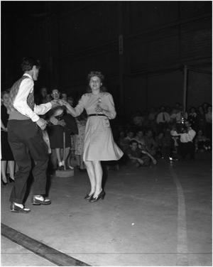 Primary view of object titled 'Couple doing the Jitterbug at Lockheed Martin performance by Frankie Masters' Orchestra'.