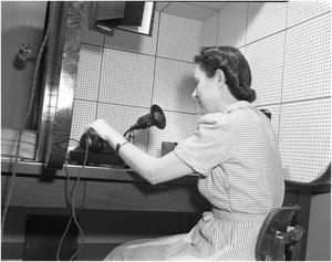 Primary view of object titled '[Woman speaking over the public address system]'.