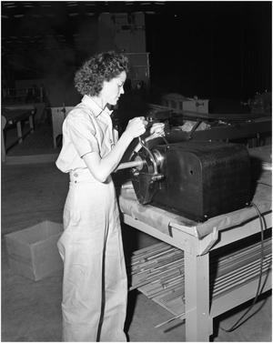 Primary view of object titled 'Girl Working on Machine'.