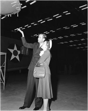 Primary view of object titled 'Helen Hayes and George Newman Observing Wing Tip'.