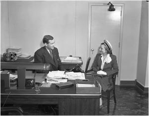 Primary view of object titled '[George Newman and Helen Hayes in Mr. Newman's office]'.