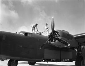 Primary view of object titled '[B-24 with men on top]'.