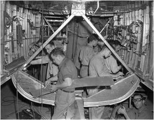 Primary view of object titled 'Ten men working inside an airplane fuselage'.