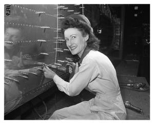 Primary view of object titled 'Virginia Foster, Riveter at Consolidated Aircraft Corporation'.