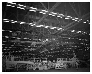 Primary view of object titled 'B-32 being carried by a monorail'.