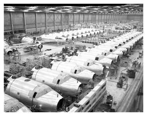 Primary view of object titled 'B-32 Assembly Line - nose and tail section line up'.