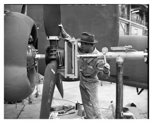 Primary view of object titled '[Wilkins Attaching Propeller to Aircraft]'.