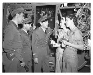 Primary view of object titled '[Military Personnel Talking with Two Female Employees]'.