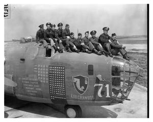 "Primary view of object titled '[Veteran Crewmen with the ""Blue Streak"" Aircraft]'."