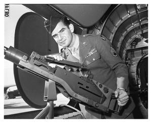 Primary view of object titled '[Sergeant Hayduk Posing with Waist Gun]'.