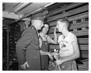 Primary view of object titled '[Lieutenant General William S. Knudsen Visits with Employees]'.