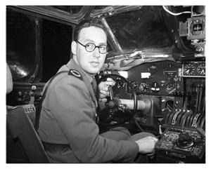 Primary view of object titled '[Peter Masefield in Cockpit of a C-87]'.