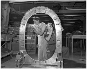 Primary view of object titled '[Two Women Working on the Tail of a Fuselage]'.