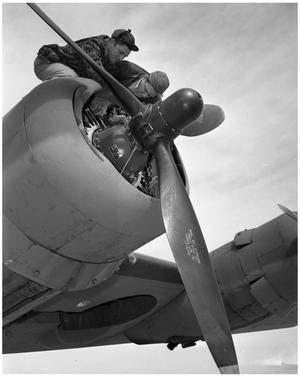 Primary view of object titled '[Two Men Above the Propeller of an Aircraft]'.