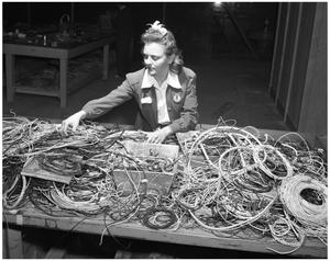 Primary view of object titled '[Woman Working at Electrical Bench]'.