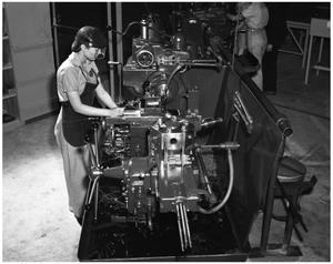 Primary view of object titled '[Sally Sparkman Working with Machinery]'.