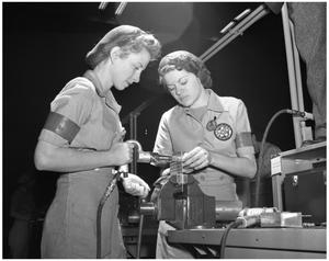 Primary view of object titled '[Two Women Performing Mechanical Work]'.