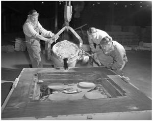 Primary view of object titled '[Three Men Working Together]'.